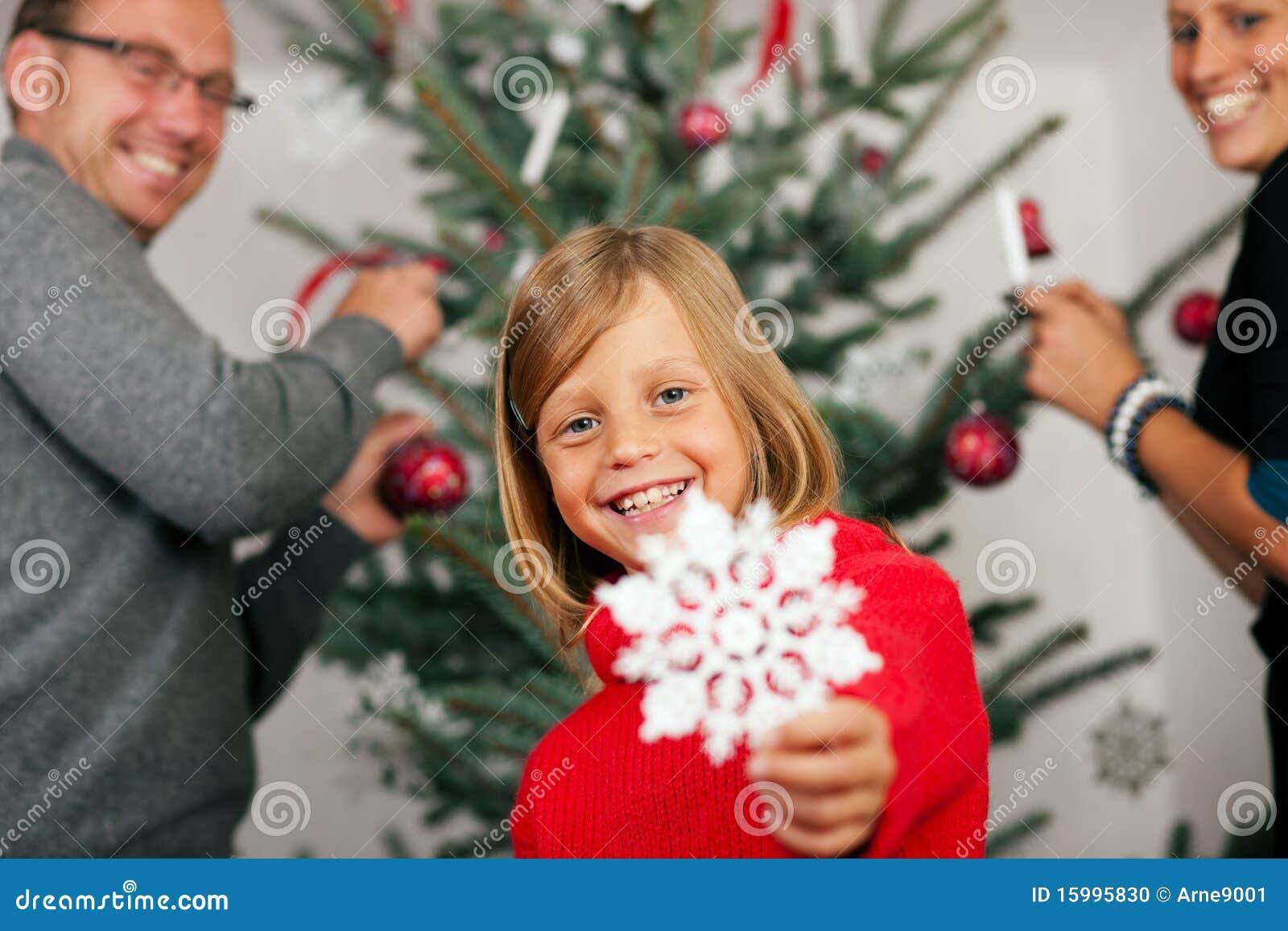 Family Decorating The Christmas Tree Stock Photo Image