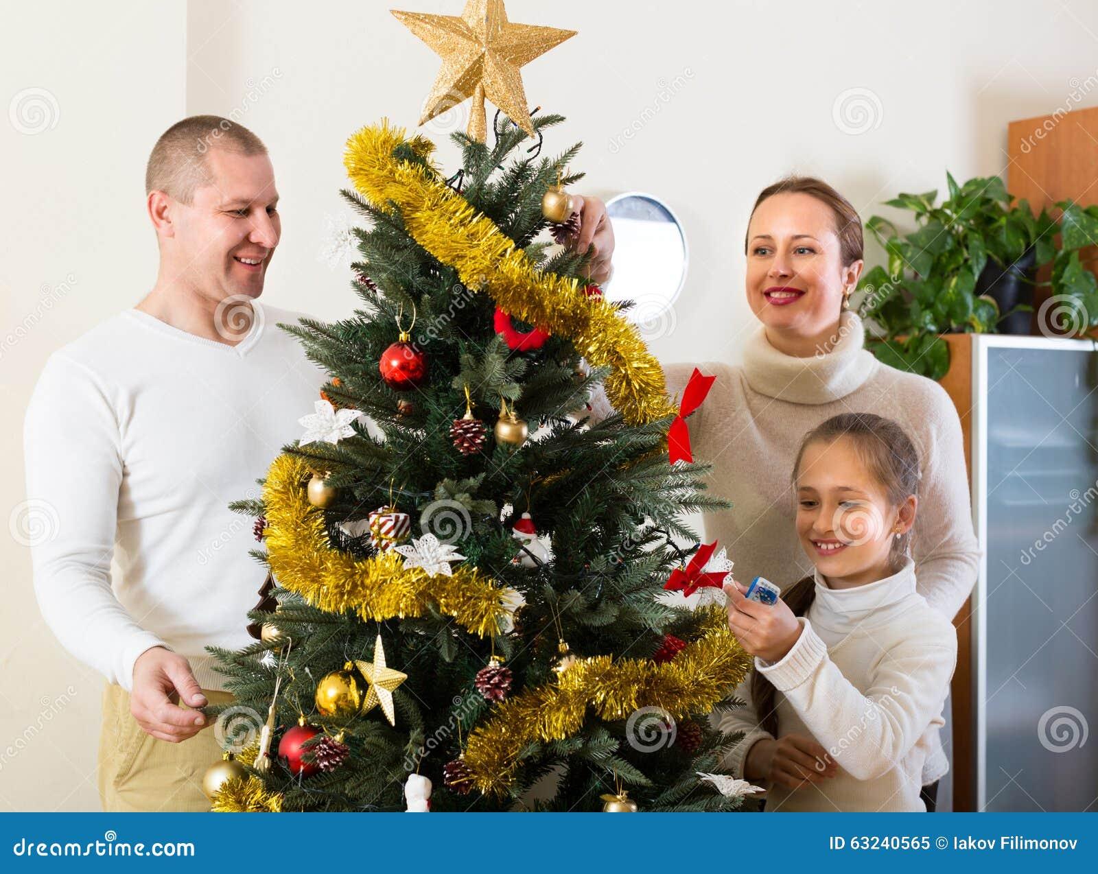 Family Decorating Christmas Tree Stock Photo Image 63240565