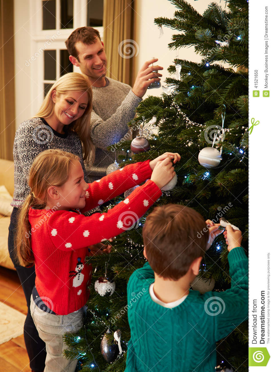 Family Decorating Christmas Tree At Home Together Stock ...