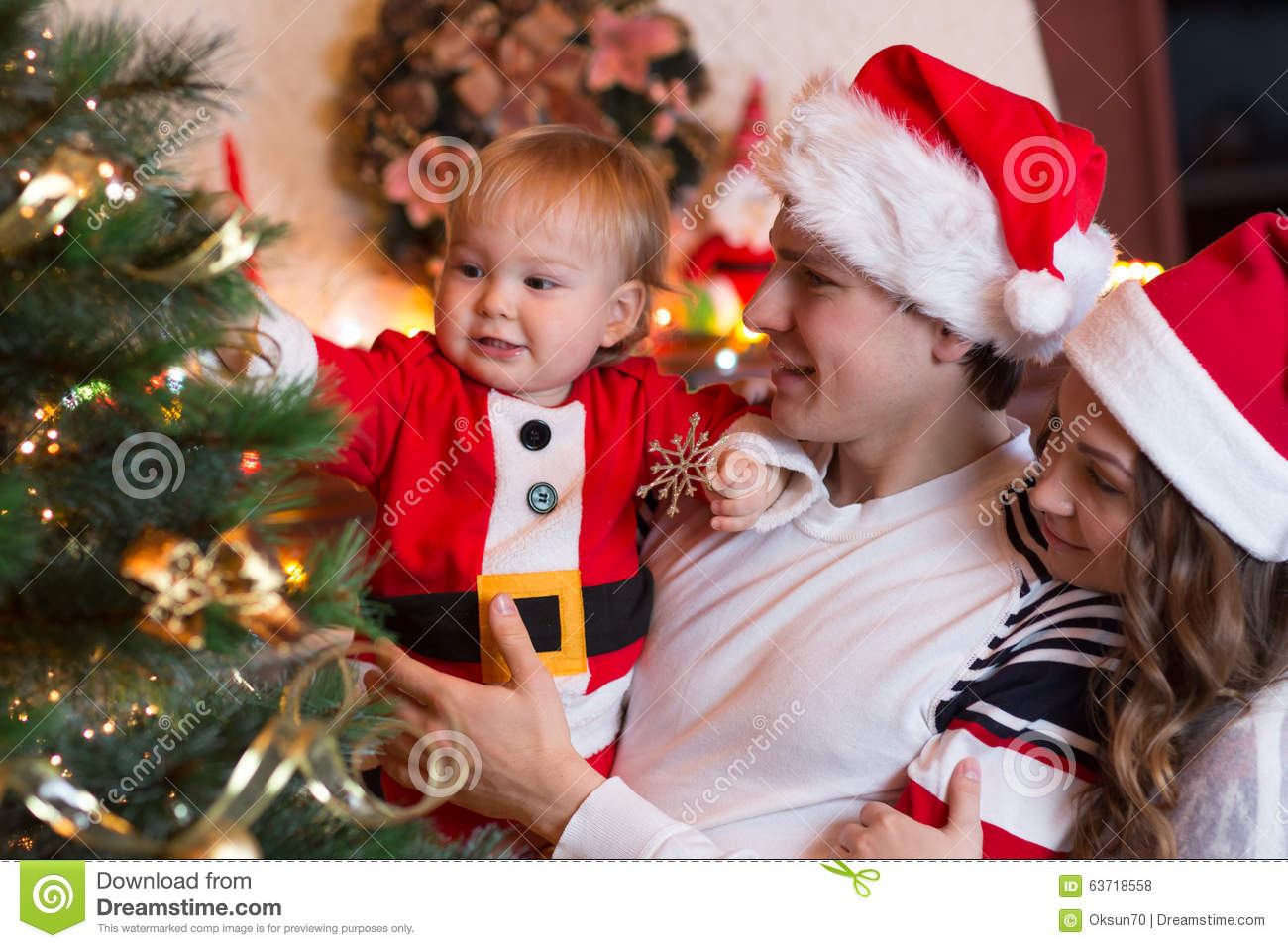 Family Decorating Christmas Tree In Living Room Stock Photo Image 63718558