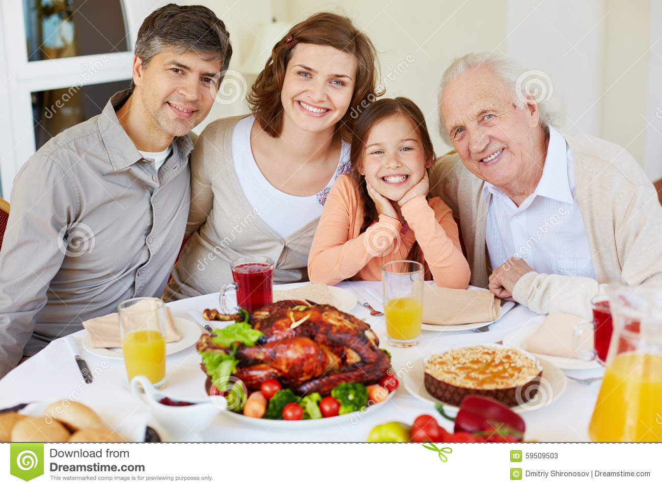 Family By Dinner Table Stock Photo Image 59509503