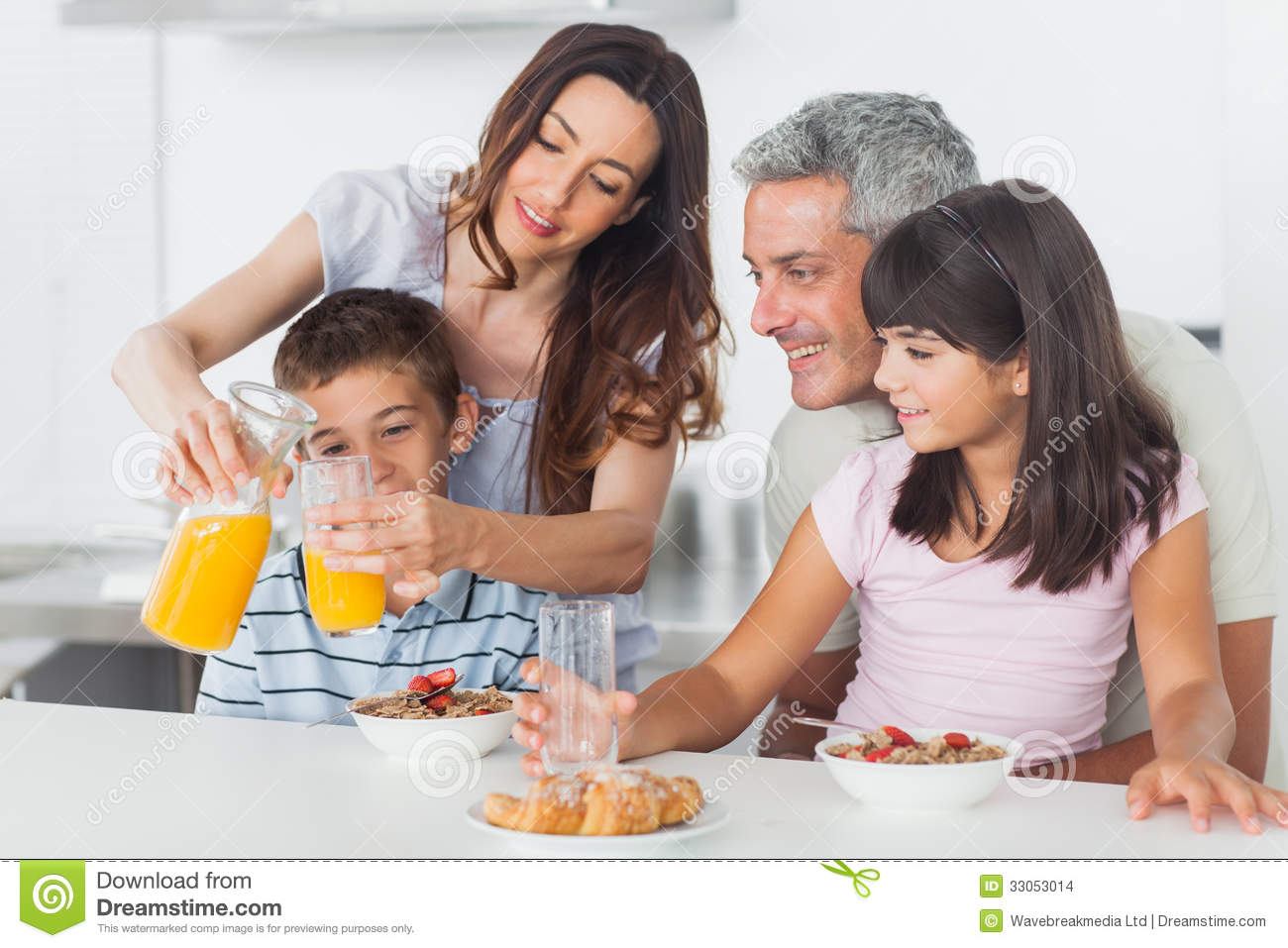 Homey App Family Eating Breakfast In Kitchen Together Stock Images