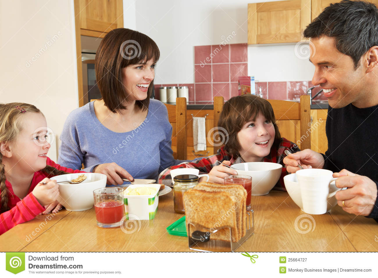 Family Eating Breakfast Together In Kitchen Stock Image ...