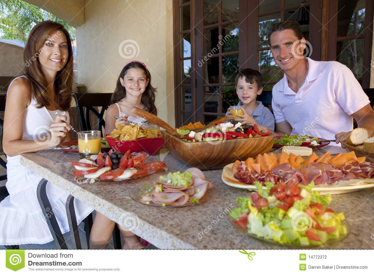 Family Eating Healthy Salad And Food Meal Stock Photography - Image ...