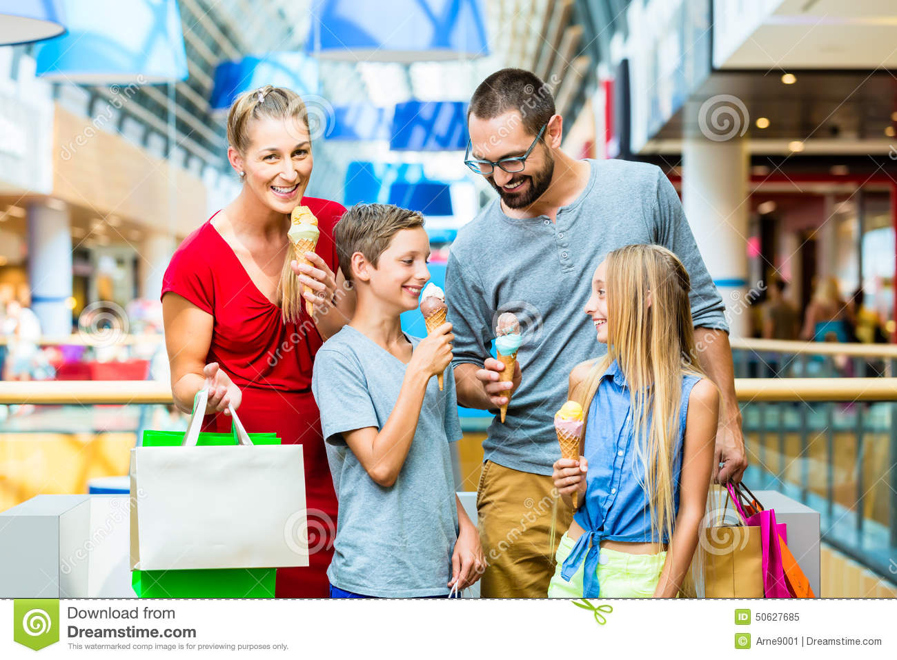 Family Eating Ice Cream In Shopping Mall Stock Photo ...