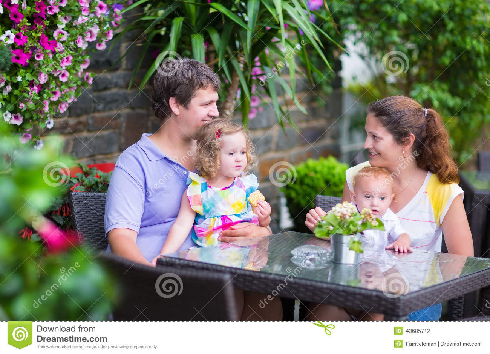 Family Eating Outside Family Eating Lunch In...