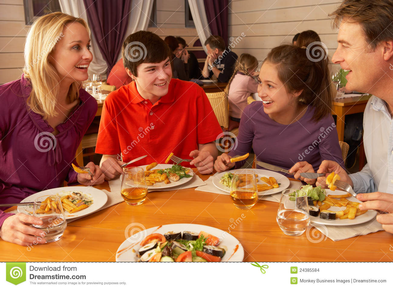 Family Eating Lunch Together In Restaurant Stock Photo ...