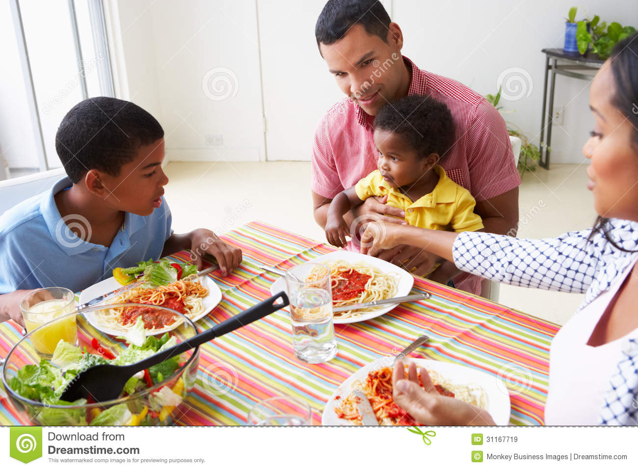 Family Eating Meal Together At Home Royalty Free Stock Images  Image