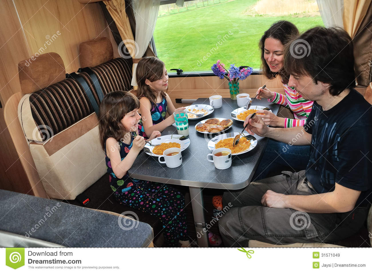 Family Eating Together In Rv Interior Stock Image Image