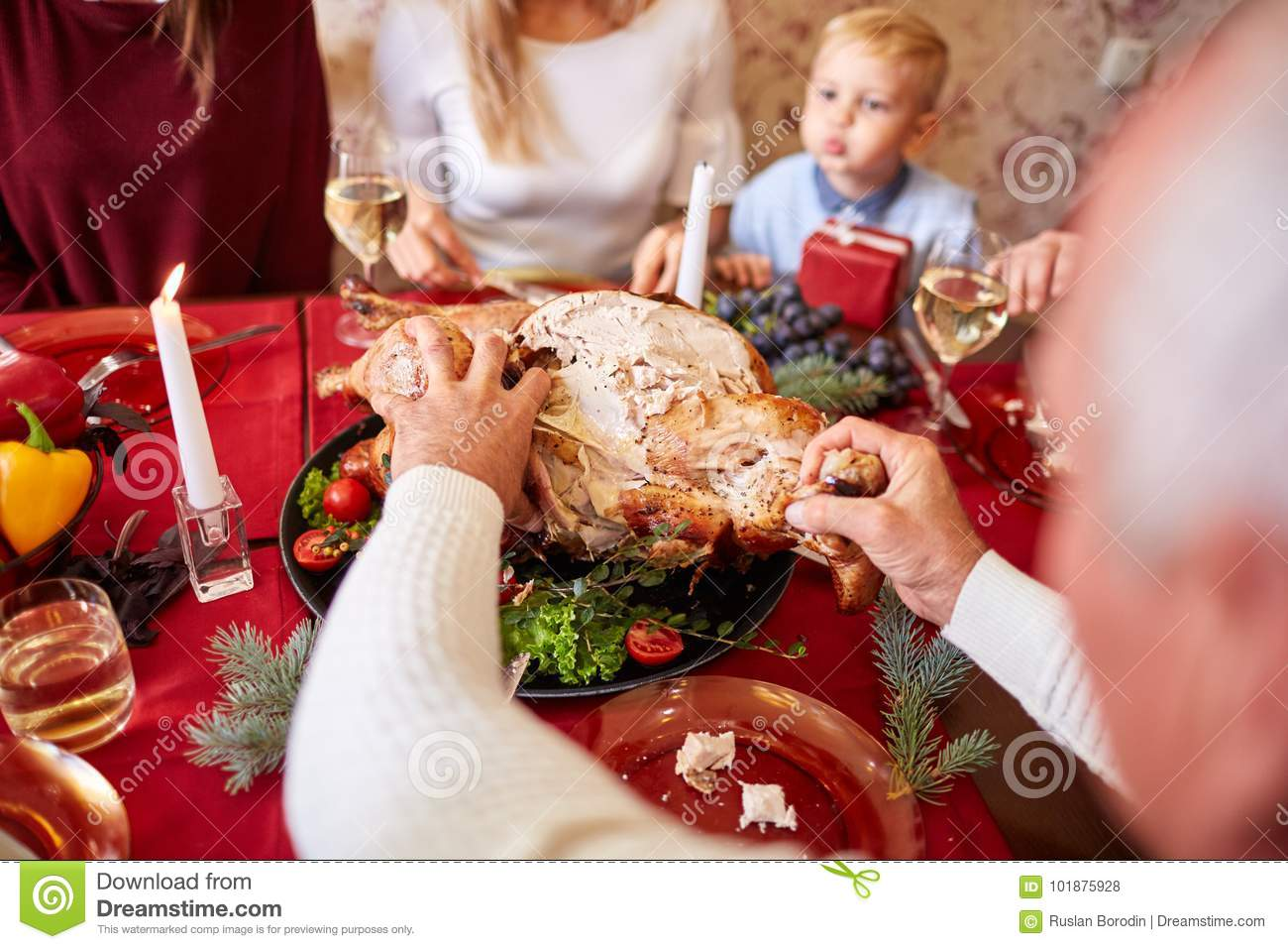 Family eating traditional Thanksgiving turkey on a festive table background. Roasted turkey. Family celebration concept.