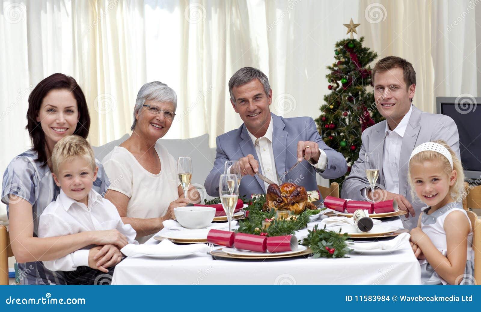 Family eating turkey in Christmas Eve Dinner