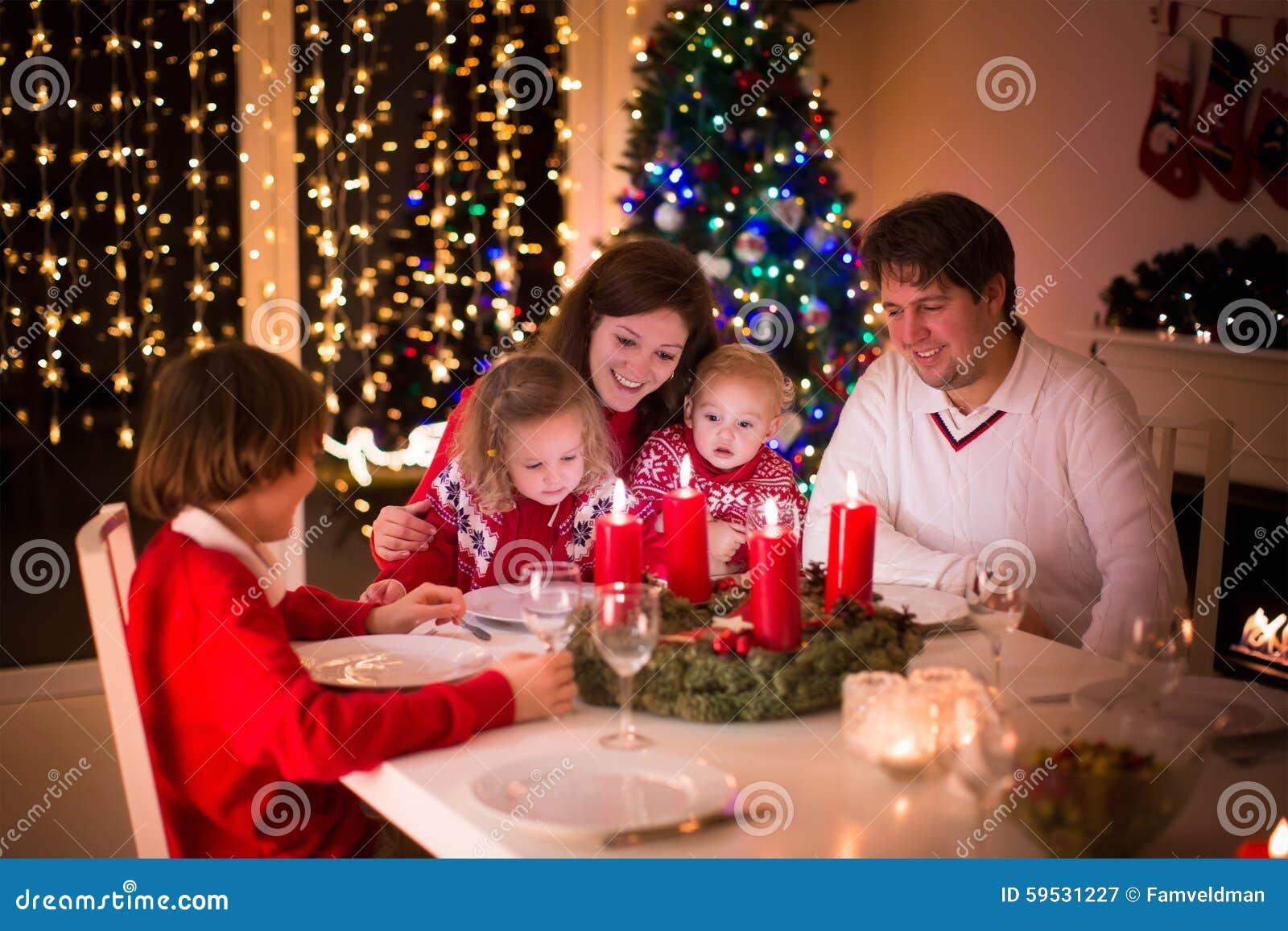 Family Enjoying Christmas Dinner At Home Stock Image