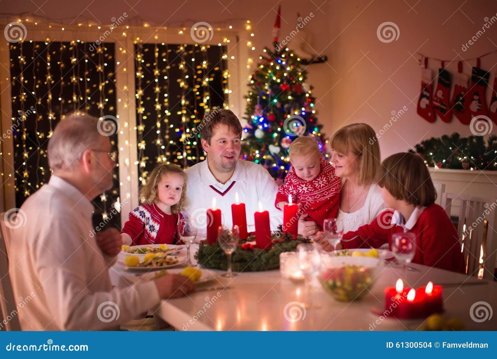 Family Enjoying Christmas Dinner At Home Stock Photo