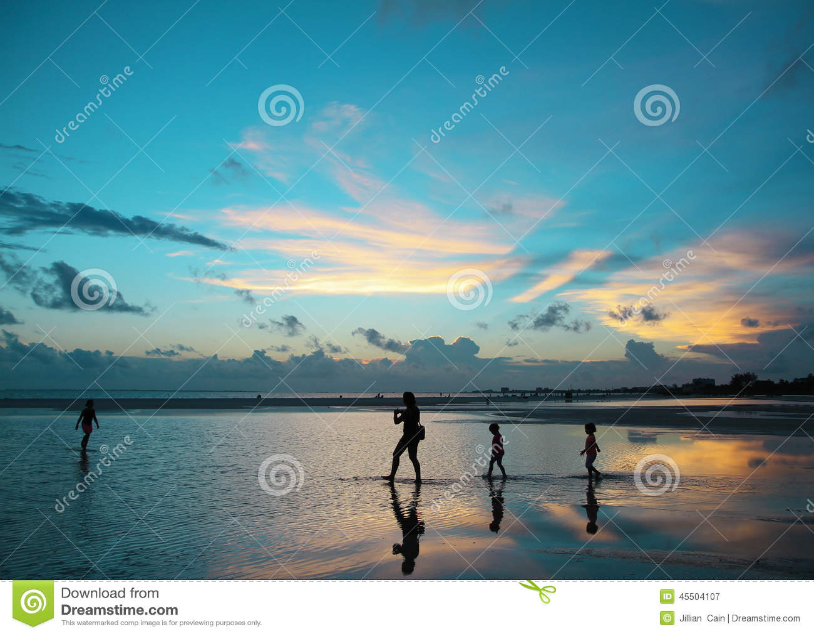 A family enjoying a dramatic blue sunset