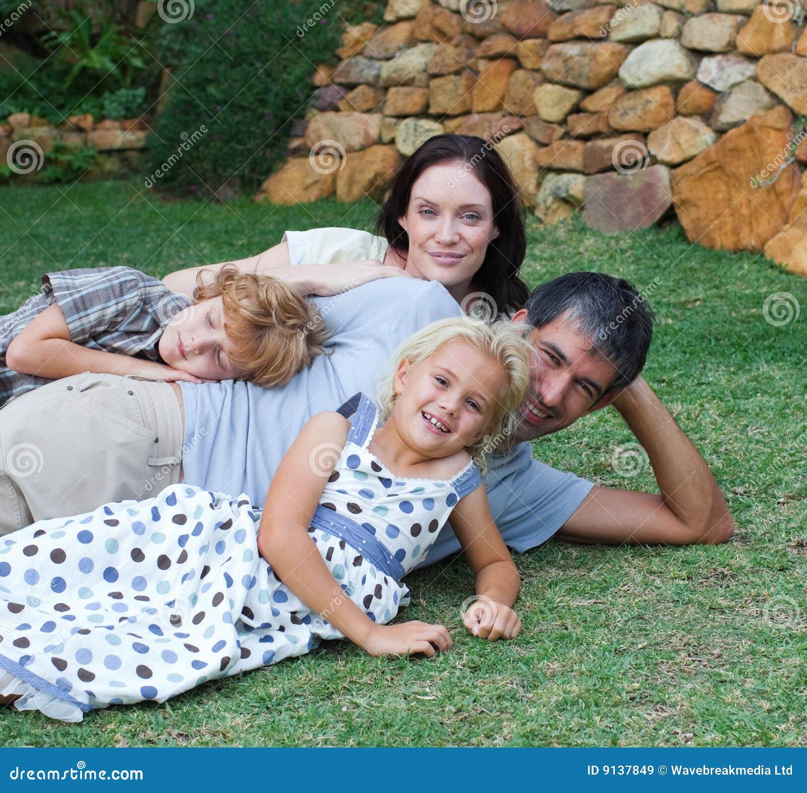 Family Enjoying Life In The Garden Stock Image