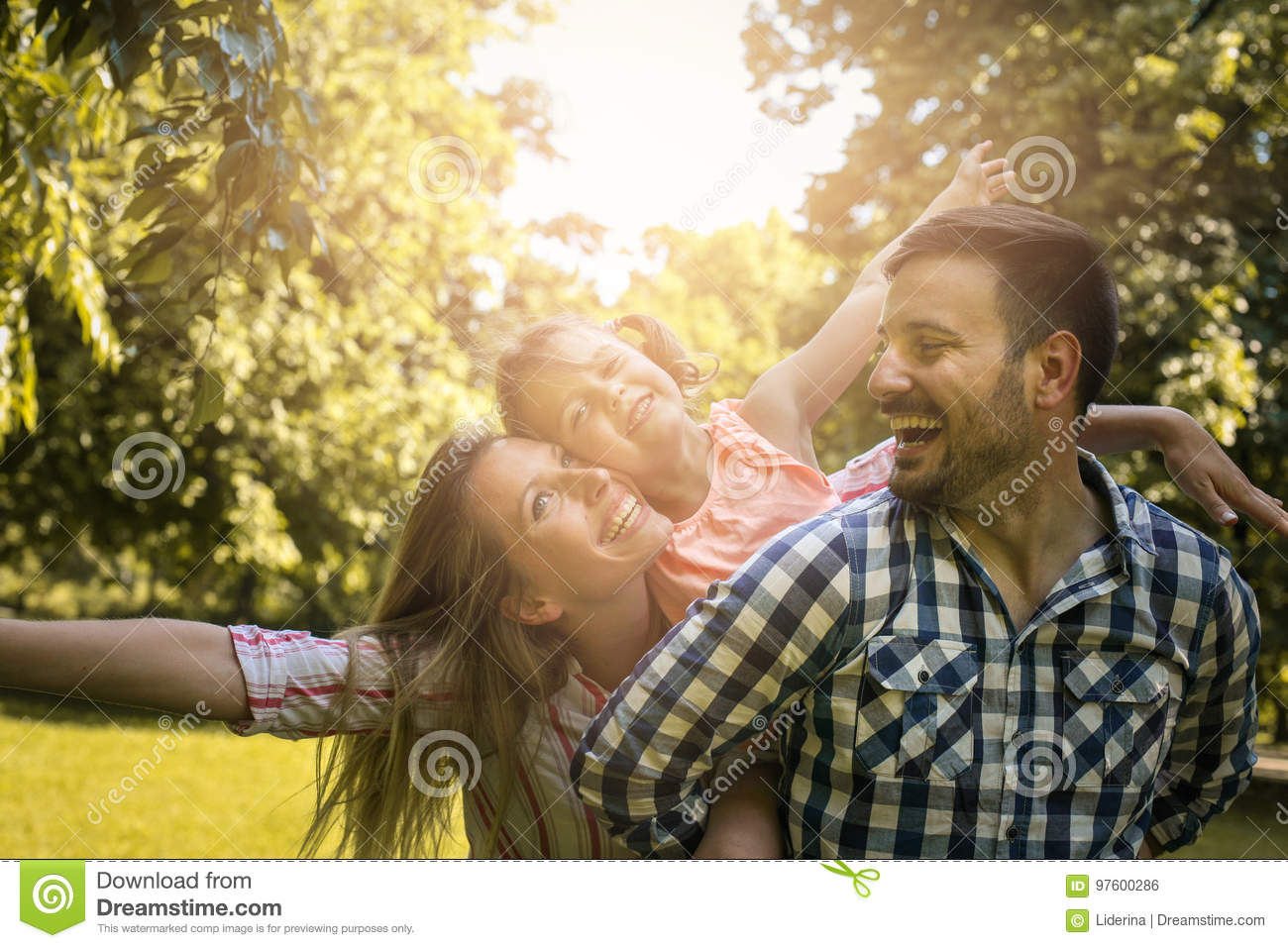 family enjoying together in summer day. Family in nature.