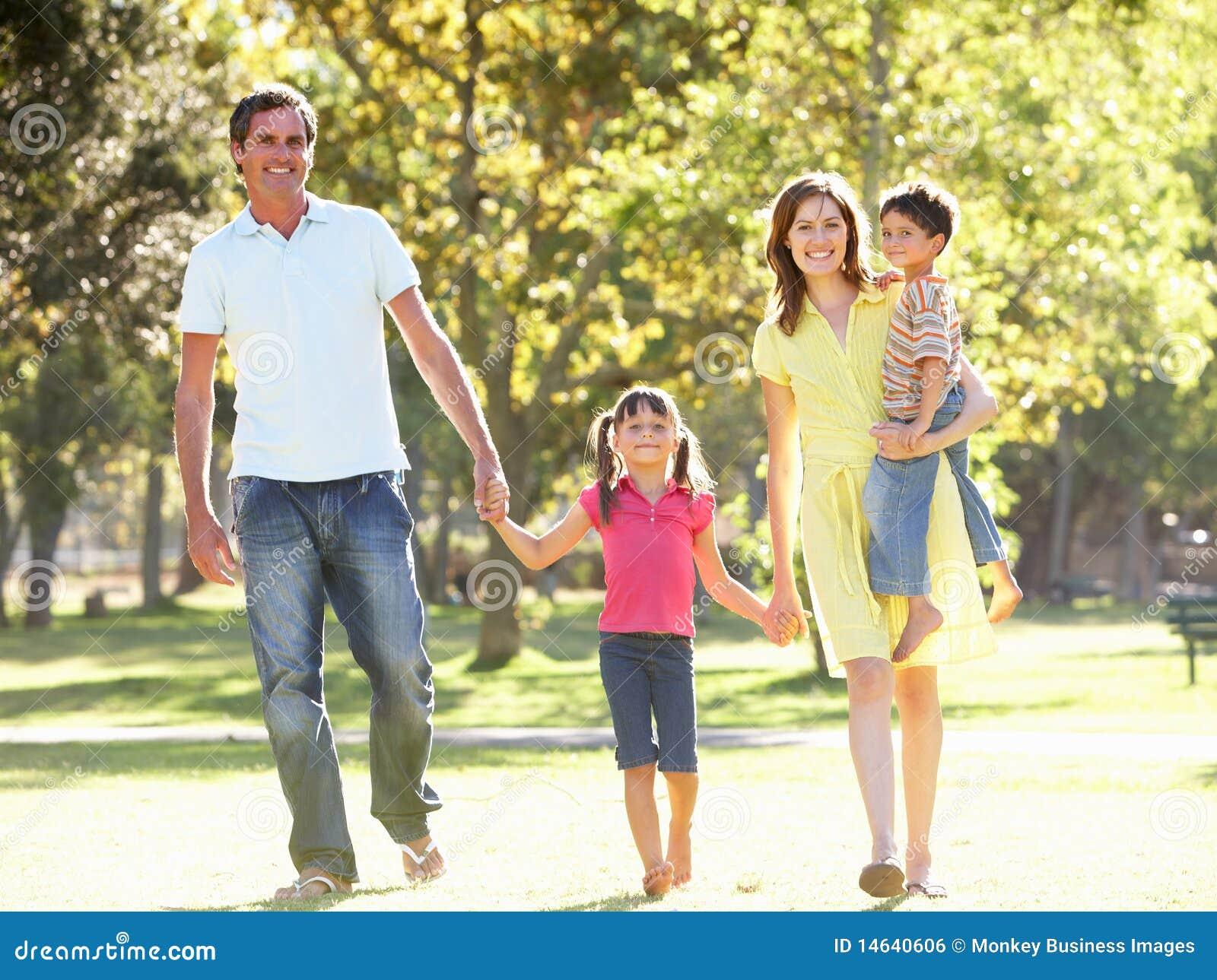 Family Enjoying Walk In Park