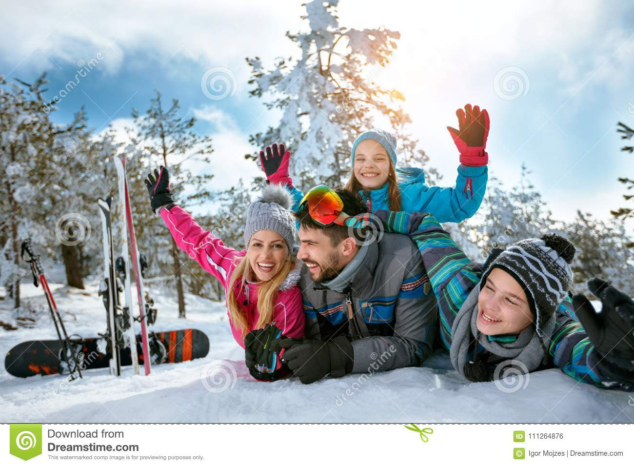 Family enjoying winter vacations in mountains on snow