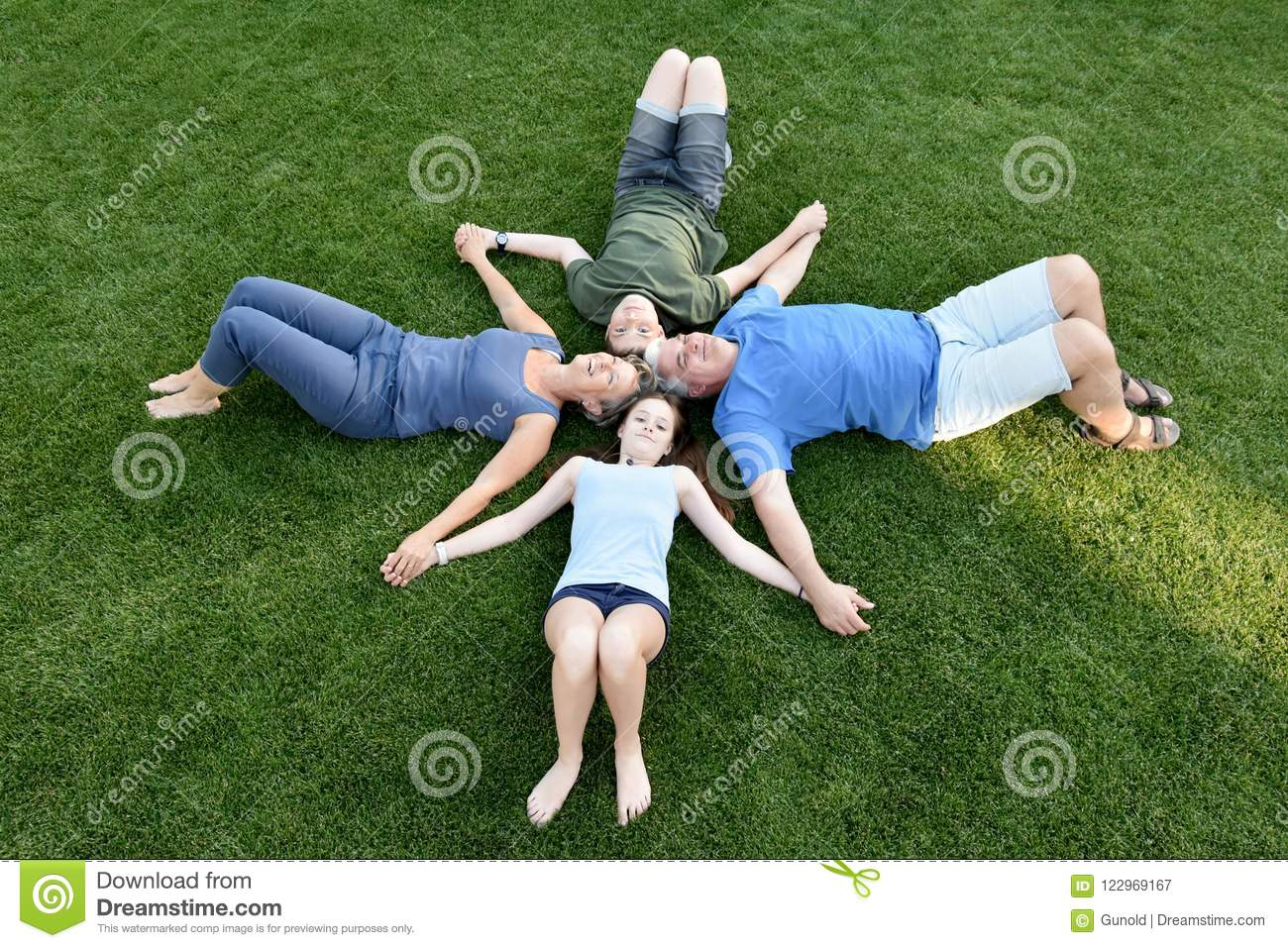Download Family, Father, Mother, Son And Daughter Lying In The Meadow Stock Image - Image of brother, grass: 122969167