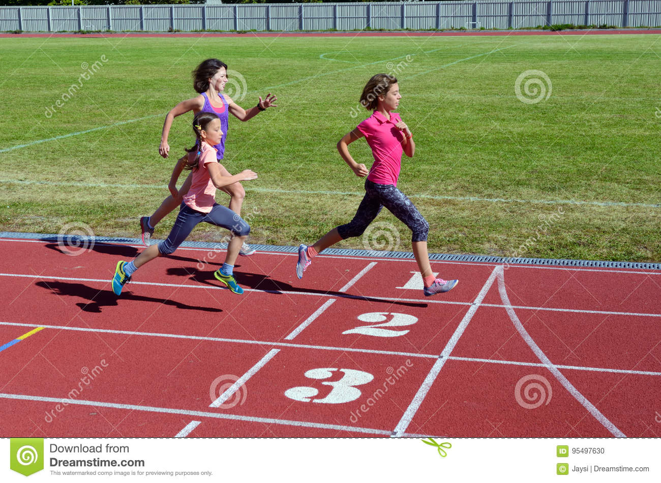 Family fitness, mother and kids running on stadium track, training and children sport healthy lifestyle