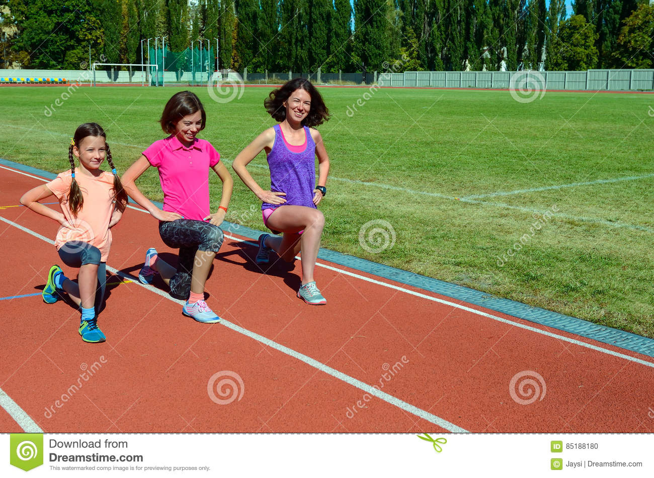 Family fitness, mother and kids training on stadium, sport with children