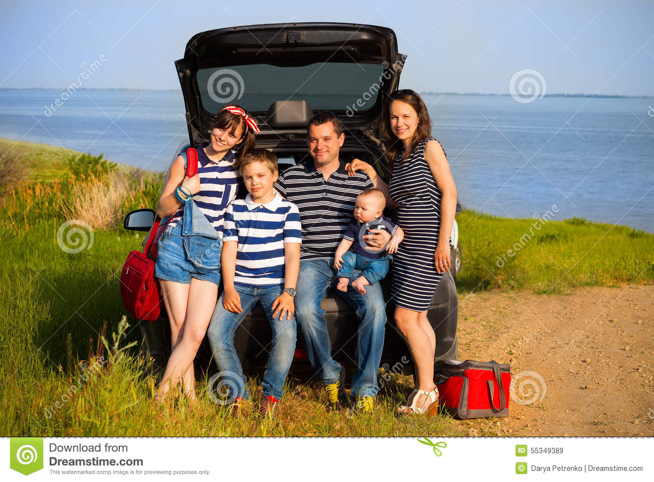 family of five having fun on the beach going on summer vacation stock photo image 55349389. Black Bedroom Furniture Sets. Home Design Ideas
