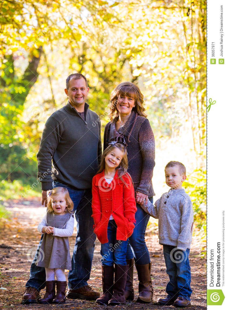 five together children mother father person three stand nuclear outdoors portrait parents outside guy