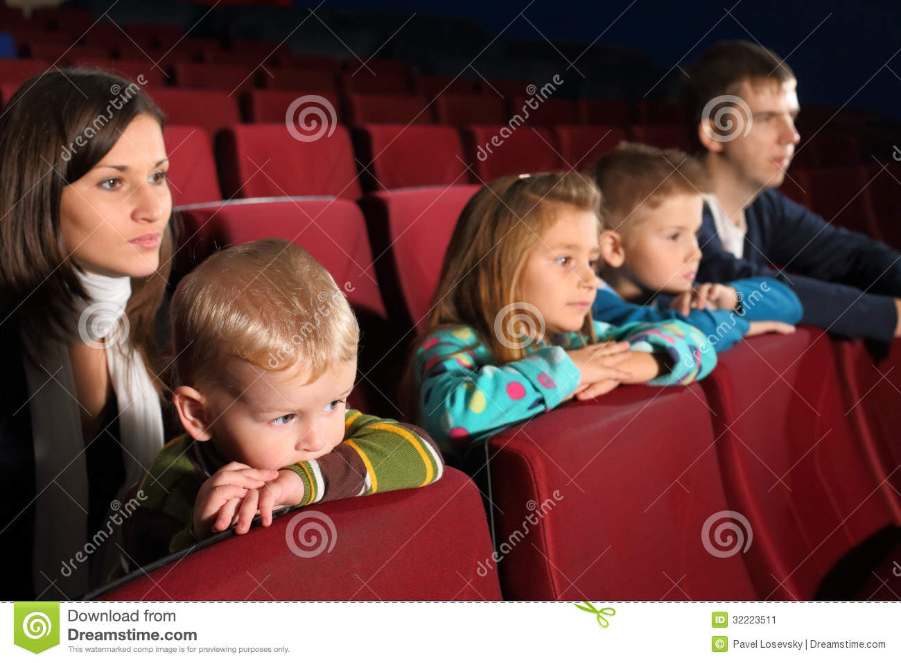Family of five people watching a movie stock image image for People watching