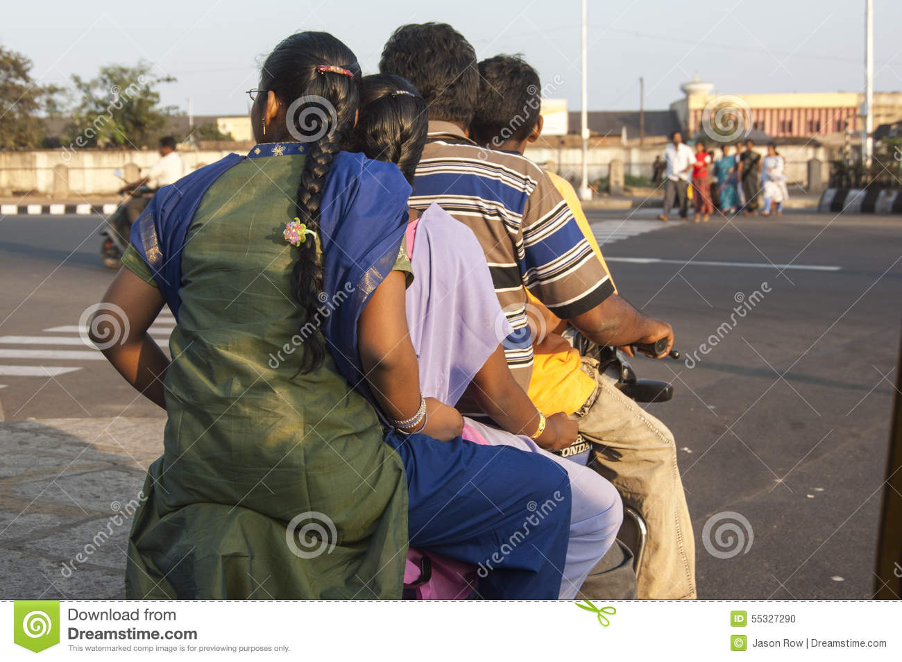 Family of four on one moped in Chennai India