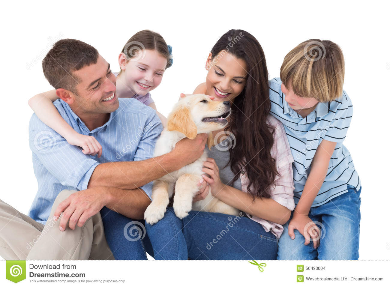 Family of four playing with dog