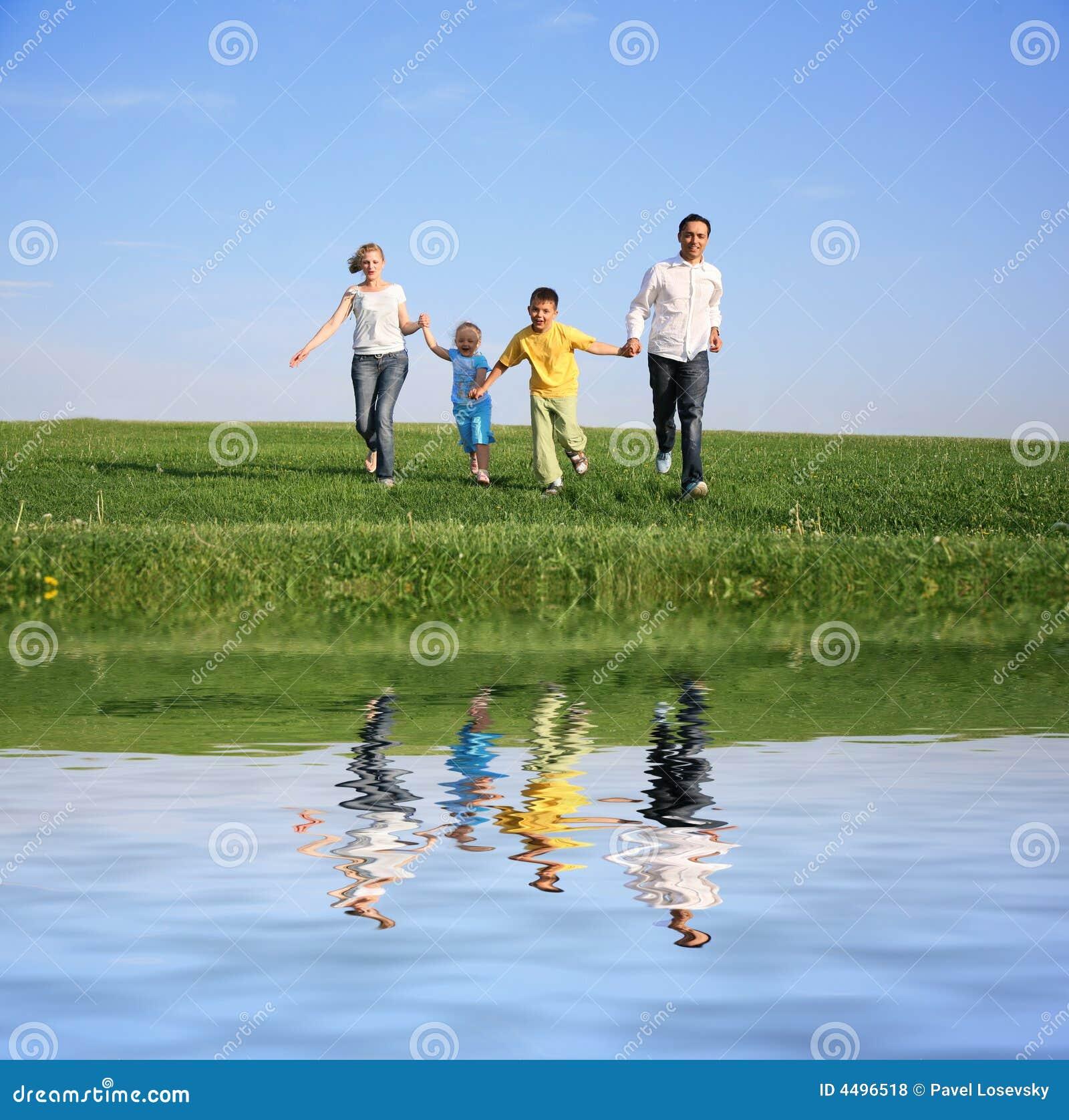 Family of four running