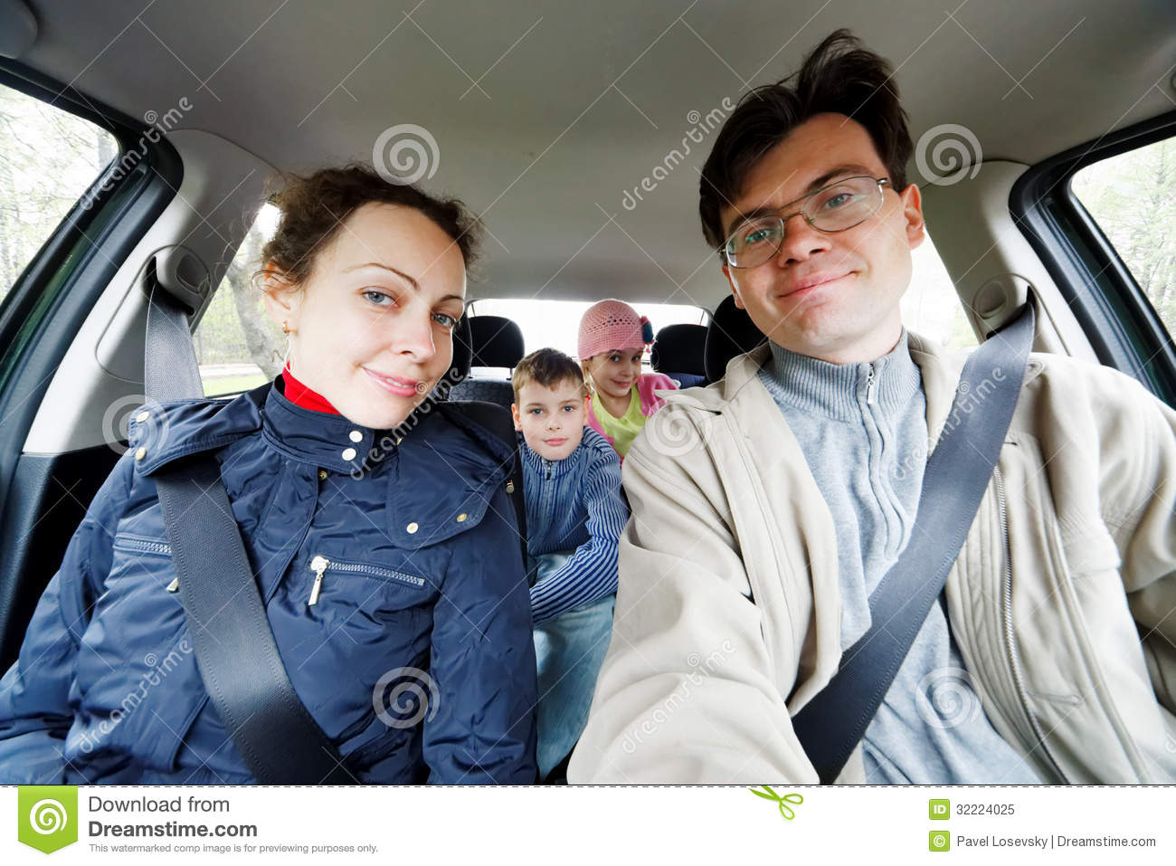Family of four sits in car