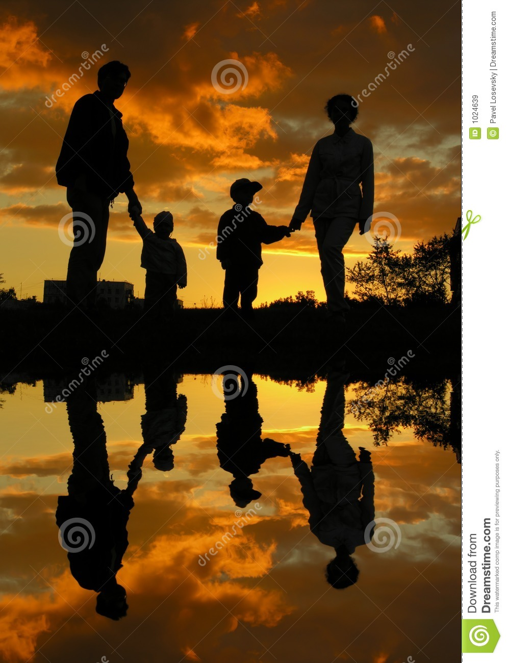 Family of four sunset water