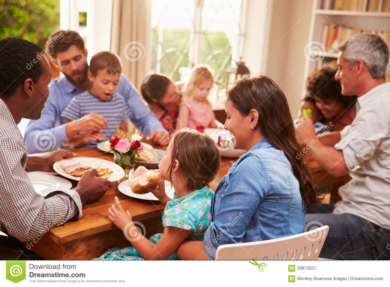 Family And Friends Sitting At A Dining Table Stock Image ...