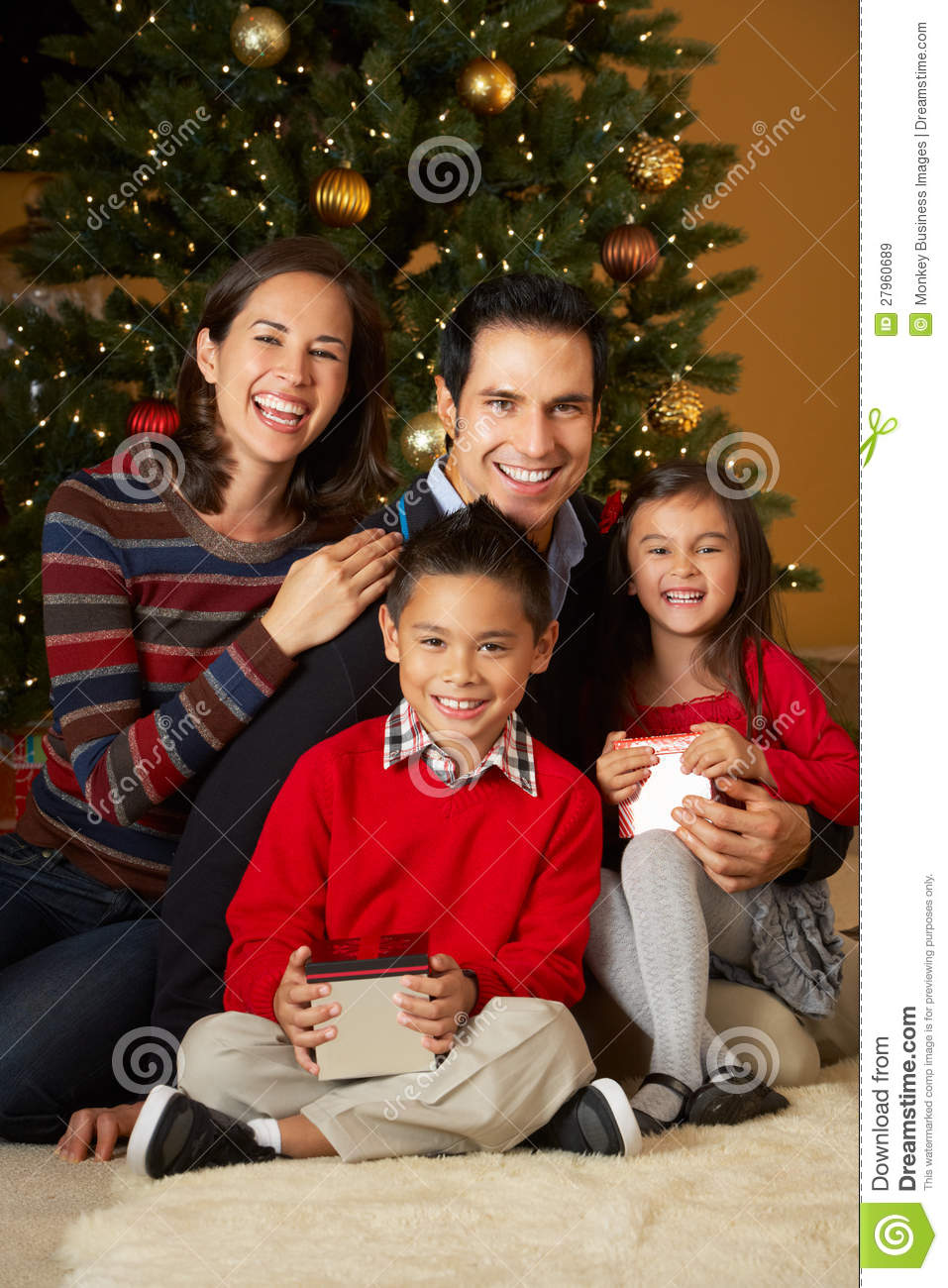 Family In Front Of Christmas Tree Royalty Free Stock
