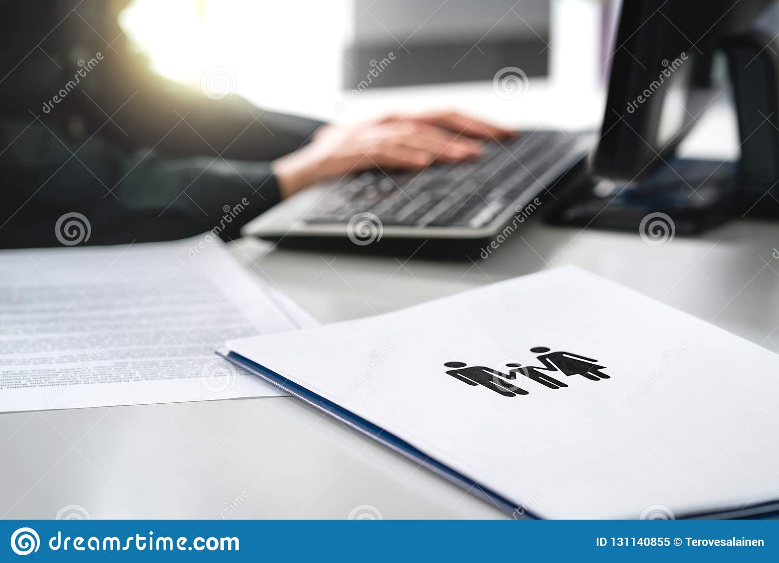Family future, health care or finance planning concept. Woman writing insurance or mortgage application with computer.