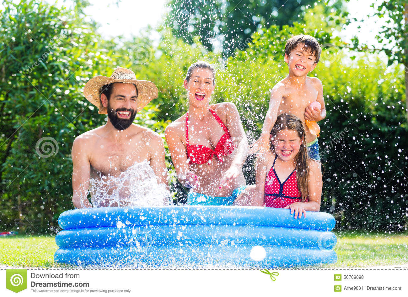 Family in garden pool cooling down splashing water stock for Family garden pool