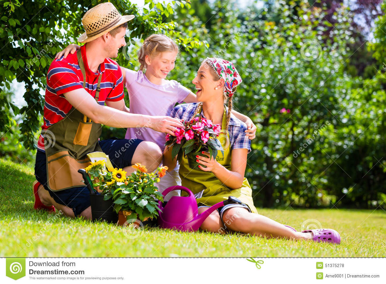 Family At Gardening In Front Of Rose Bushes Stock Image 43709011