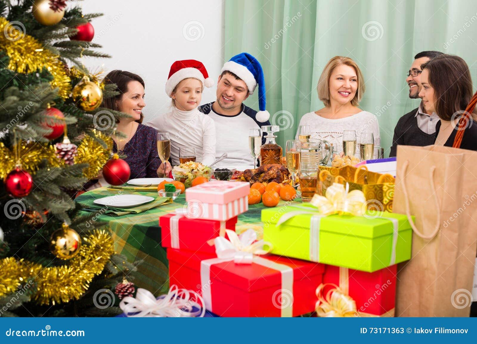 Family Gathering Together For Christmas Celebration Stock