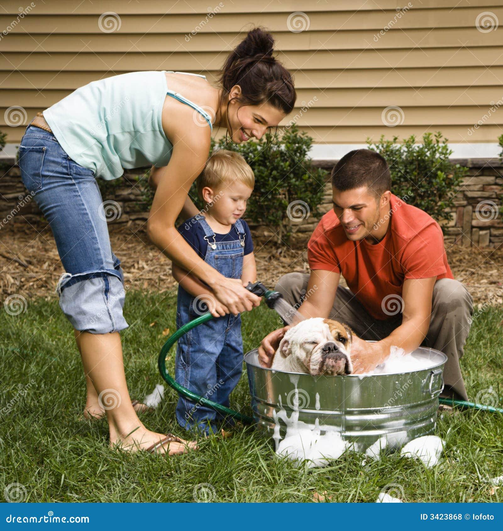 Family Giving Dog A Bath. Stock Photo. Image Of Baby, Bath
