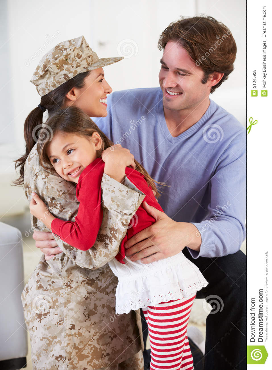 Family Greeting Military Mother Home On Leave