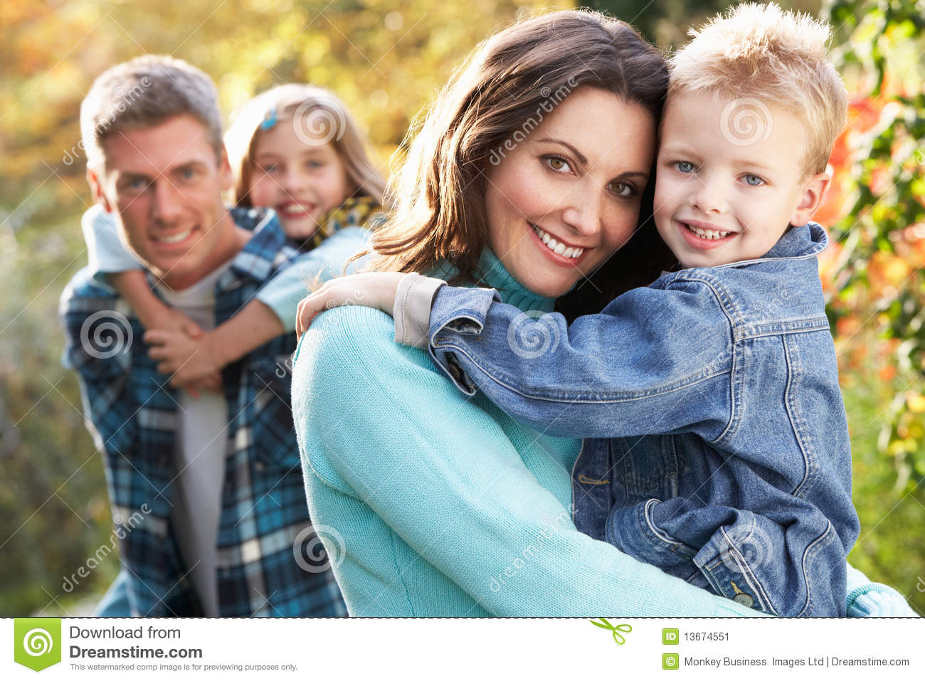 Family Group Outdoors In Autumn Landscape