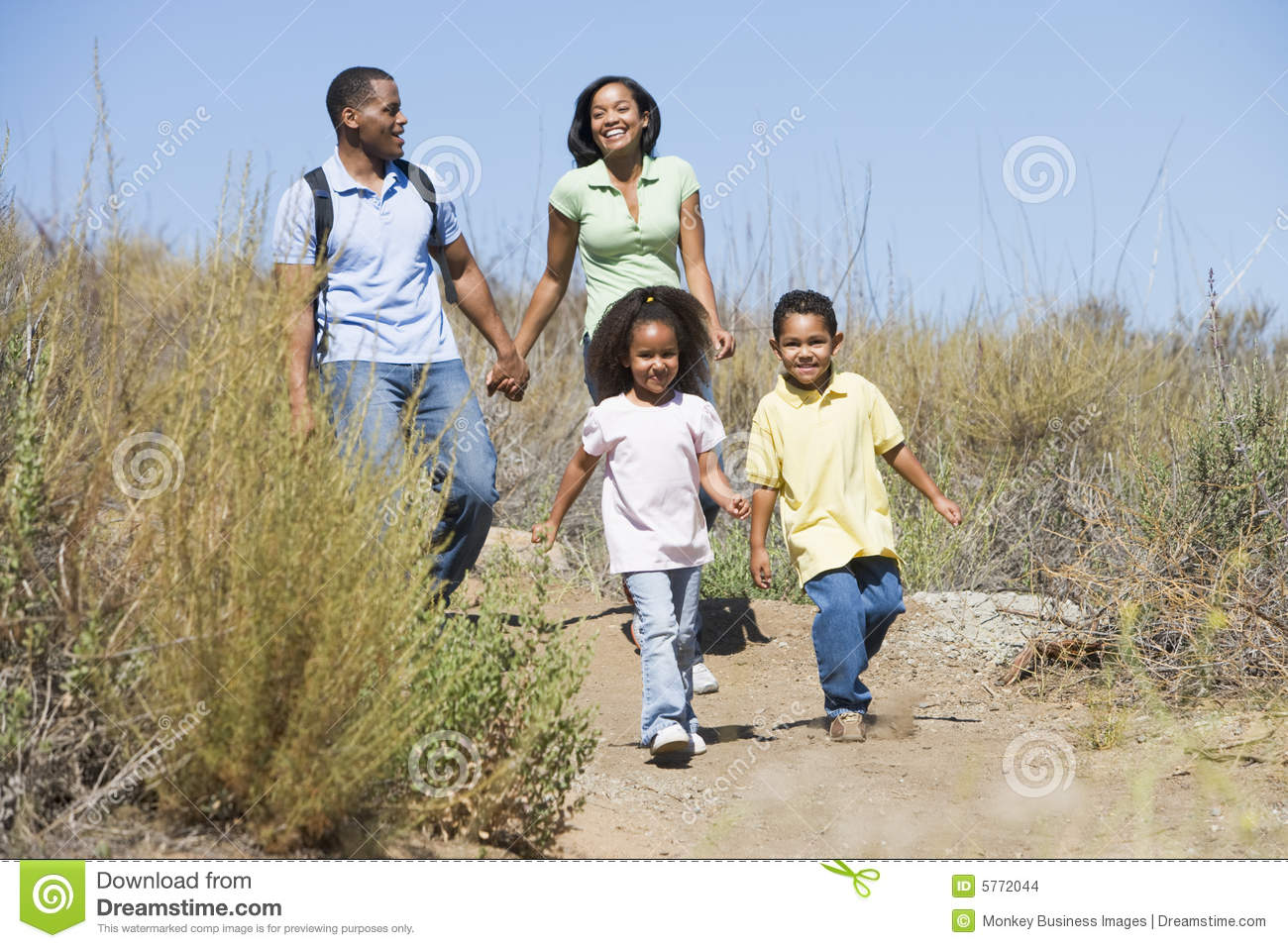 Family hands holding path smiling walking