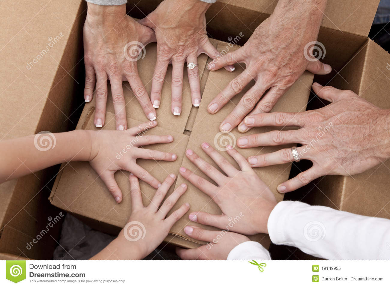 Family Hands Unpacking Boxes Moving House Royalty Free