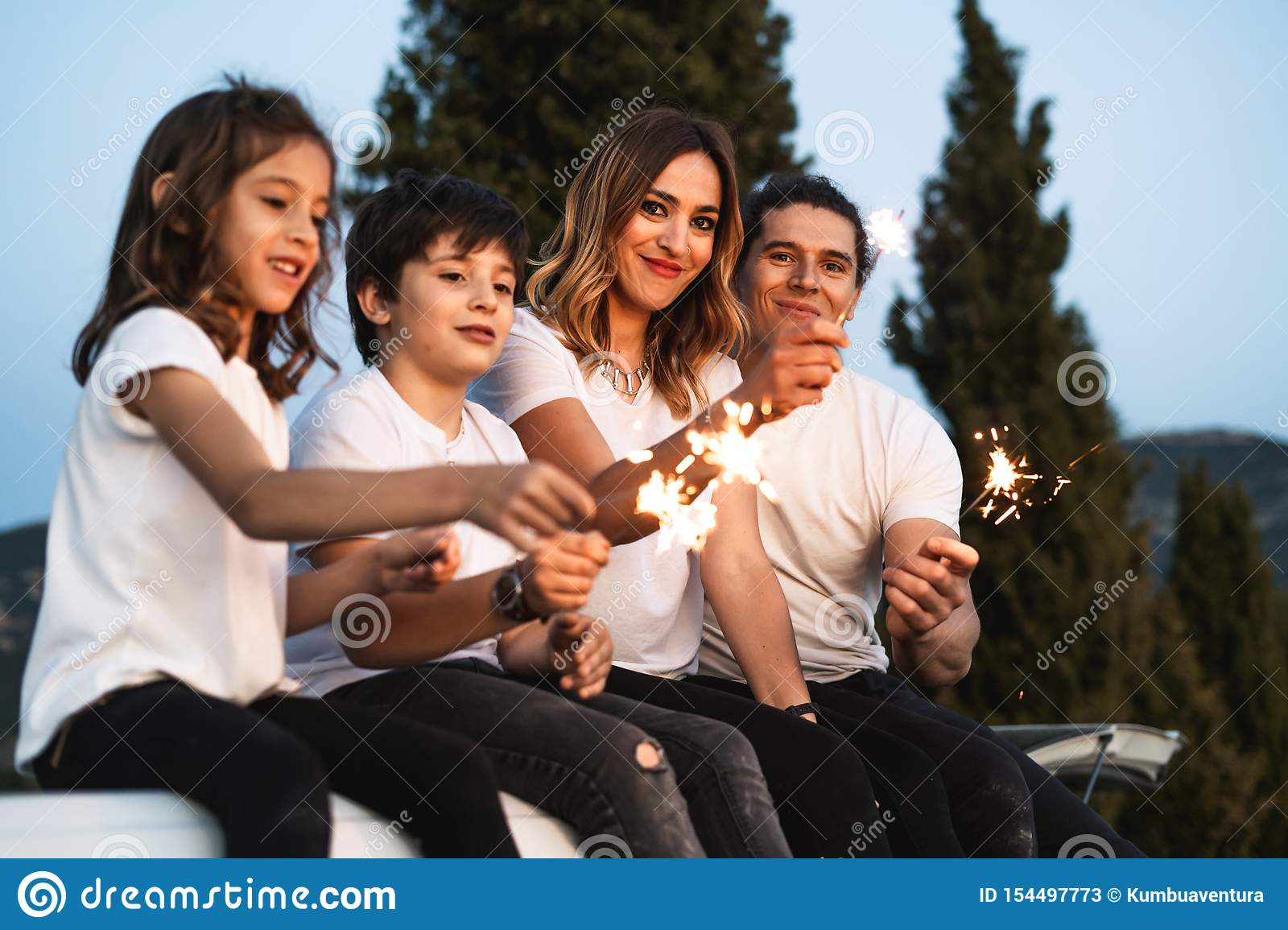 Family with happy sparklers