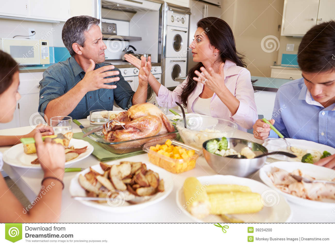 Family having argument sitting around table eating meal for Eating table