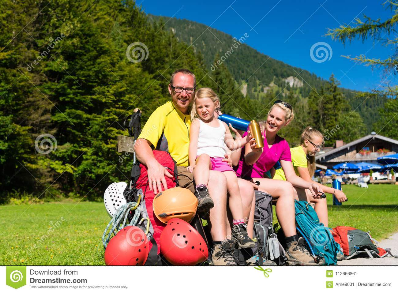 Family having break from hiking in the mountains