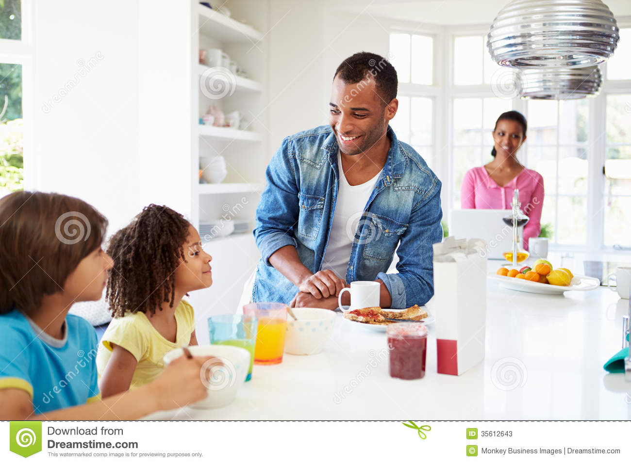Family Having Breakfast In Kitchen Together Stock Photos ...