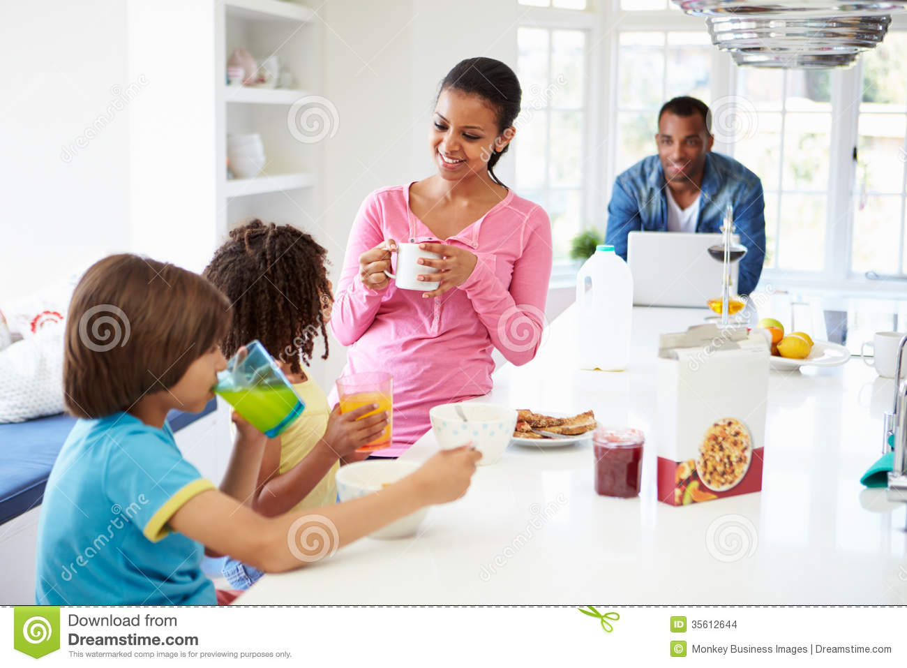 Family Having Breakfast In Kitchen Together Stock Images ...