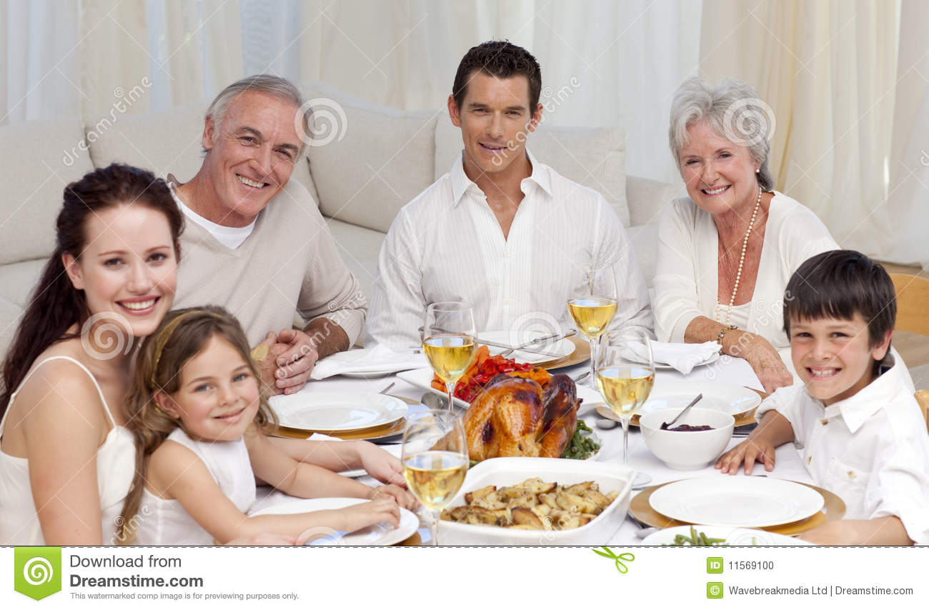 Family Having A Dinner Together At Home Stock Photo ...
